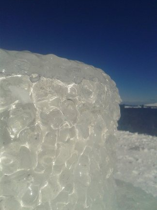 block of ice with clear sky