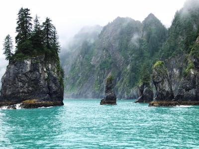 photo of rocks in an ocean