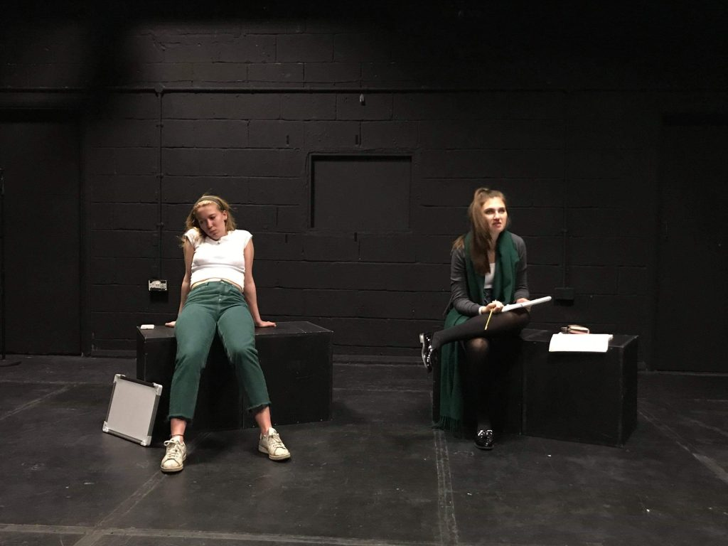 2 girls on stage for a Number Theory play