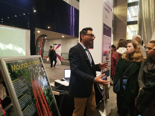 Dr. Singh at an event talking to students