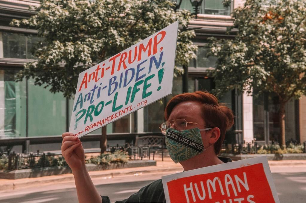 Pro-life protester via Maria Oswalt on Unsplash