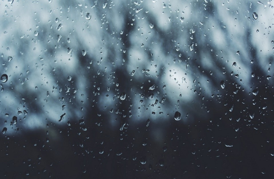 raindrops on a window with a blurred background