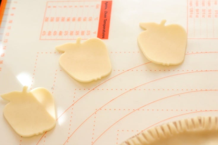 cutting out the apple shapes from pie crust
