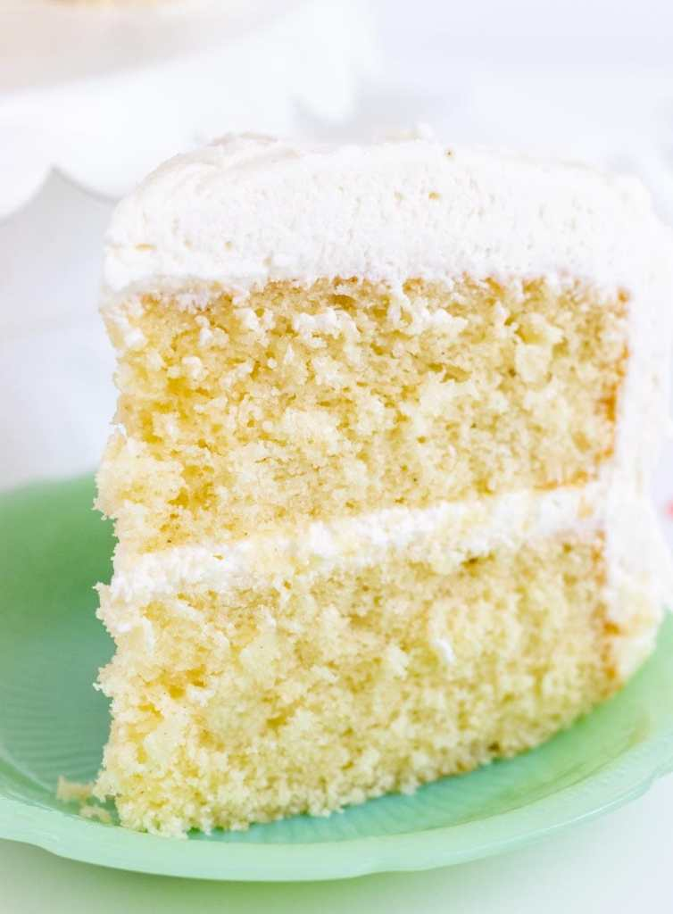 Vanilla bean cake on a green plate