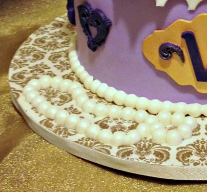 Gilded scrapbook paper covered cake board