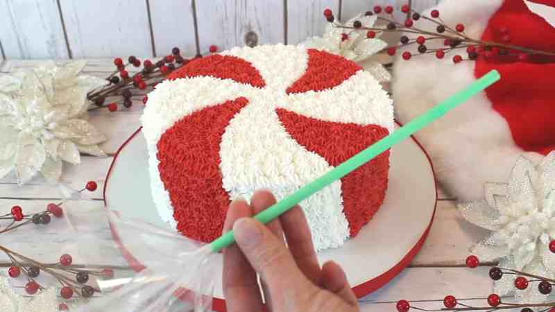 Inserting cellophane into straw for the peppermint candy cake