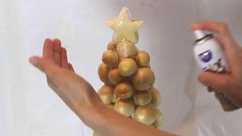 Spraying the Cake Pop Christmas Tree