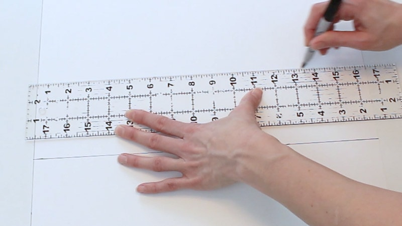 drawing the line connecting the measurements on poster board