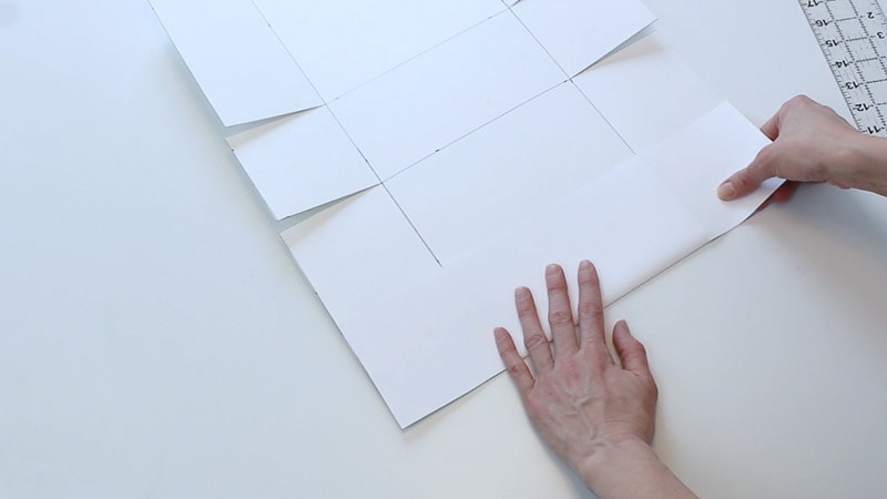 folding all the middle lines on the poster board