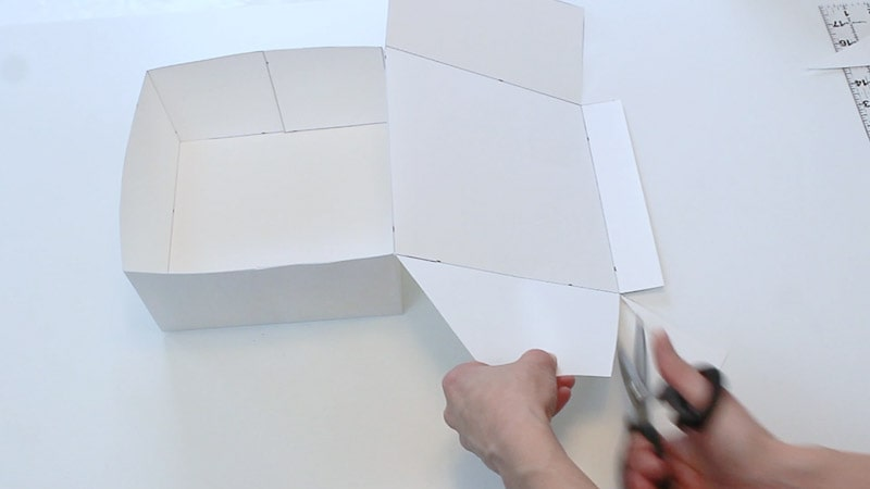 cutting the cardboard lid flaps at an angle