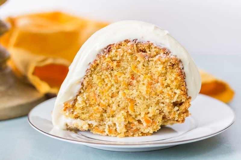 caramel carrot cake bundt cake slice on a white plate