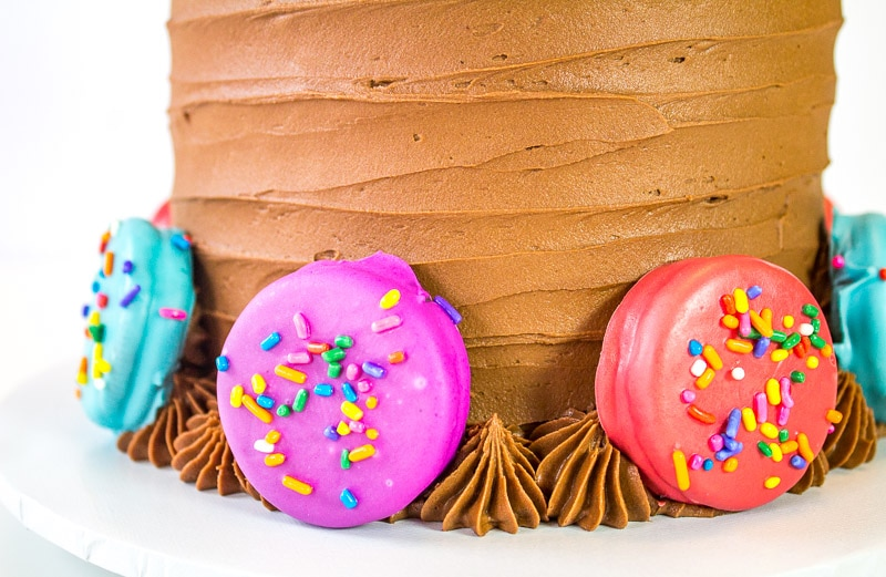 oreos dipped in candy melts attached to oreo insanity cake