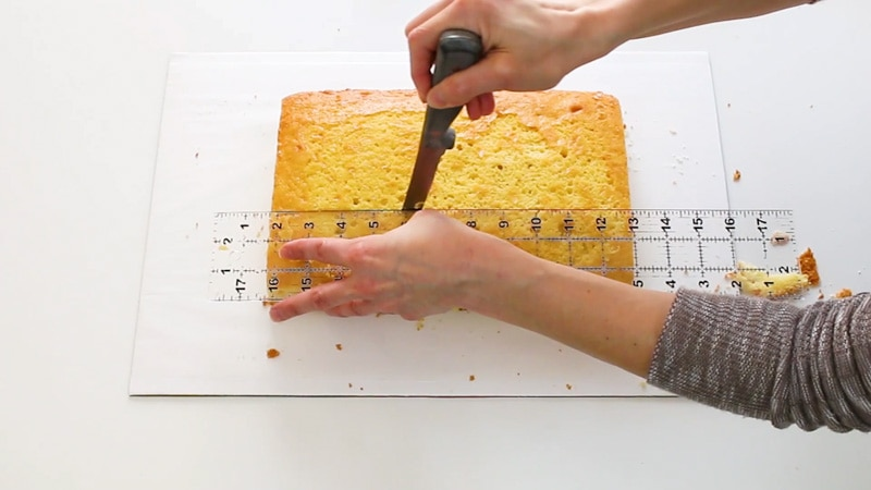Cutting the cake into equal sections for the floral initial cake