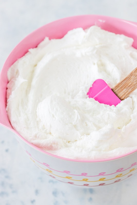 white buttercream in a pink bowl