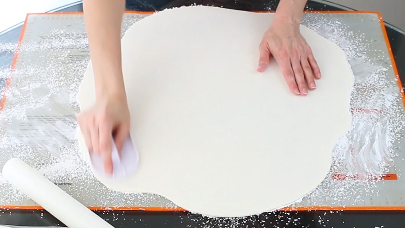 Smooth fondant with a smoother before you add to cake