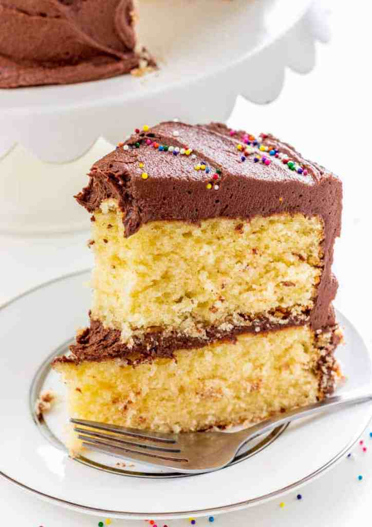 Classic Yellow Cake with Fudge Frosting with bite taken out