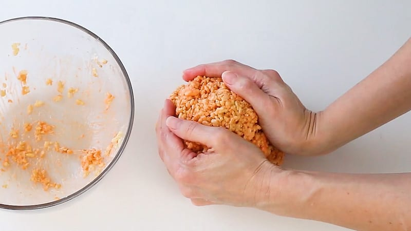 shaping rice krispie treats into a ball