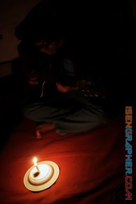 photo 2 : a guitar man with candlelight