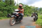 a man riding motobike