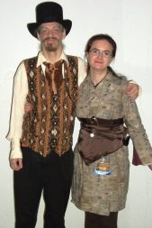 Rob in Victorian-style vest and cravat, me in Steampunk kimono and cincher with sash. Photo by Tim Smith.