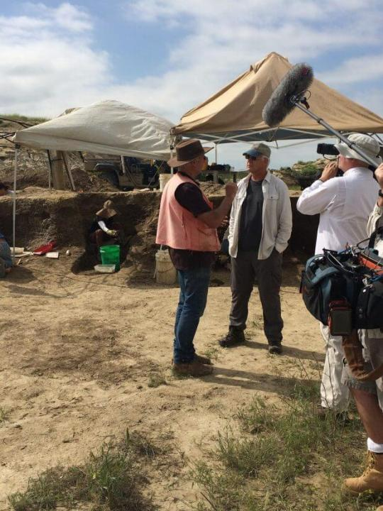 Art Chadwick and Del Tackett talking at a dig site