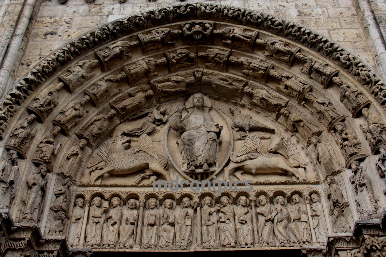 entering chartres cathedral through the central portal Stained glass of christ entering jerusalem and the chartres cathedral royal portal central tympanum over search results for chartres cathedral christ stock.