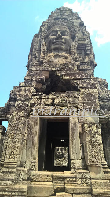 Smiling Faces of Bayon Temple and tourists
