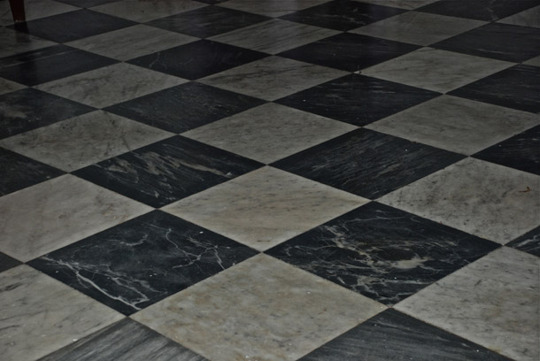 The Black and White checkered marble floor
