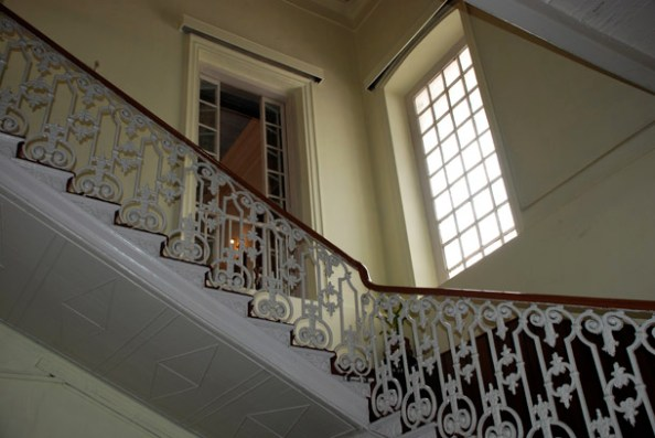 The grand wooden staircase leading to the Magistrate's private residential area