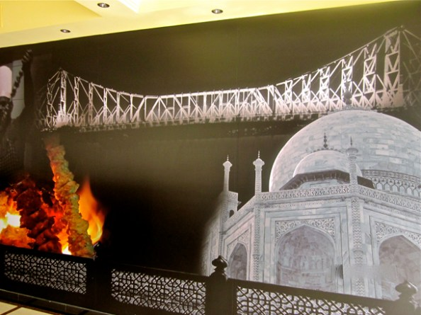 The huge wall decor which fuses both Kolkata & Lucknowy nostalgia