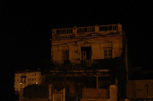 The same dilapidated building on the sea-side - at Night time