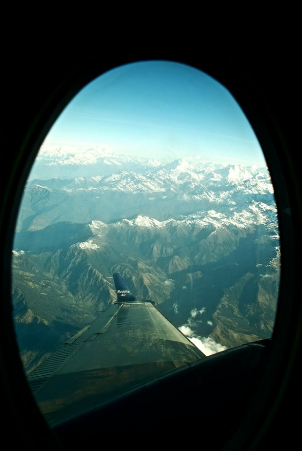 The first glimpse of the snow-capped Himalaya as we ascend - Buddha Air peeping through!