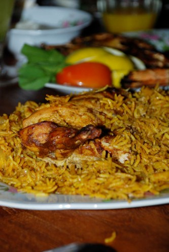 Dajaj or Chicken cooked with Yellow Rice simmered in chicken stock and special Arabic spices and dry lemon