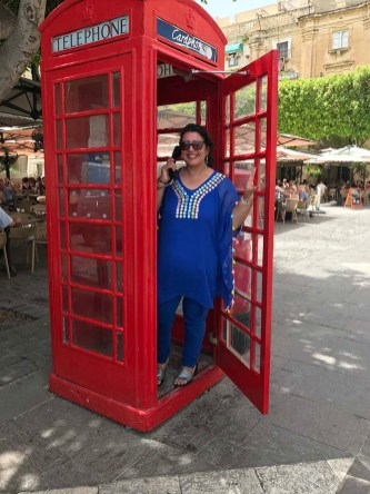 Traditional British telephone booths can be found all around Malta