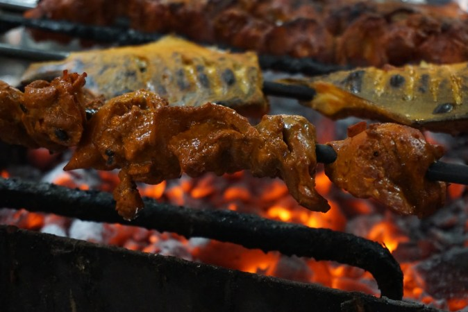 Chicken tikka in the grill at Sind Punjab