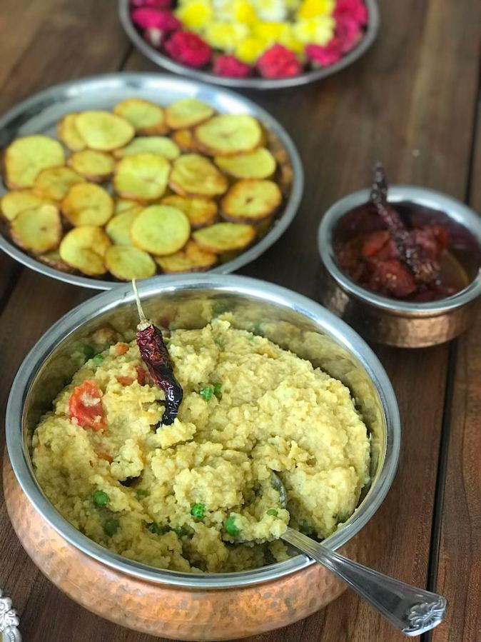 Khichuri and Aloo bhaja cooked in the festive way