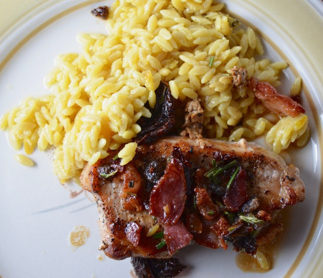 Pork Chops With Sundried Tomato-Bacon Topping With Creamy Saffron Orzo