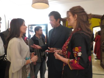 Artist Faiza Shaikh speaking to the chief guest, Imran Khan, at the launch of her art exhibition titled 'Music Never Stops' at Cafe Soul in Islamabad.