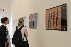 """Visitors at the photo exhibition """"60 SOLUTIONS against climate change"""" in PNCA, Islamabad. Photo: Sana Jamal"""