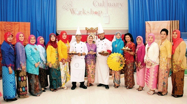 Participants of Coffee Morning and Culinary Workshop pose for a photograph with the wife of Indonesian ambasador, Rita Amri. Photo: Khalid Raja