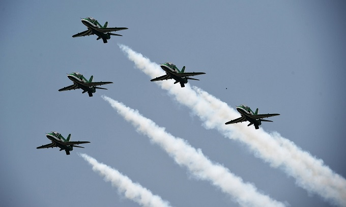 An aerobatic team performs during the air show on Independence day celebrations in Islamabad on August 14, 2017.