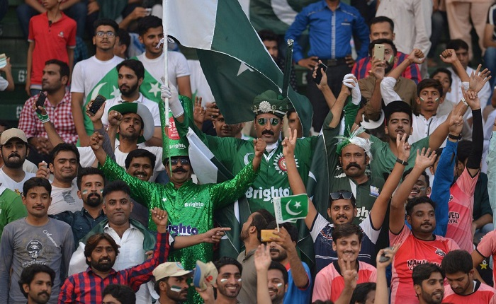 Pakistani spectators cheer at the start of the first Twenty20 international match between the World XI and Pakistan at the Gaddafi Cricket Stadium in Lahore on September 12, 2017 - AFP