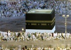 Tens of thousands of Muslim pilgrims move around the Kaaba (center) inside the Grand Mosque in Mecca, Saudi Arabia on November 3, 2011. (Hassan