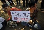 Protesters hold a sign as they participate in a demonstration to mourn the death of a rape victim, who was assaulted in New Delhi, in Mumbai December 29, 2012. The Indian woman, whose gang rape sparked protests and a national debate about violence against women in India, died of her injuries on Saturday, prompting a security lockdown in New Delhi and an acknowledgement from India's prime minister that social change is needed. REUTERS/Vivek Prakash (INDIA - Tags: CRIME LAW CIVIL UNREST)