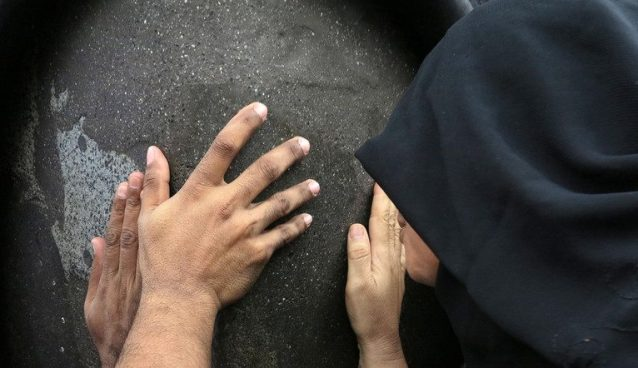 Worshippers touch the black stone of the Kaaba, the cube-shaped stone structure draped in black cloth that Muslims around the world face during daily prayers inside the Grand Mosque in the holy Muslim city of Mecca, Saudi Arabia, Monday, July 8, 2013. Mecca is regarded as the holiest city in the religion of Islam. (AP Photo/Hadi Mizban)