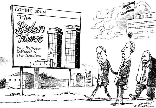 """""""بايدن"""" والمستوطنات.. كاريكاتير """"هيرالد تريبيون"""""""