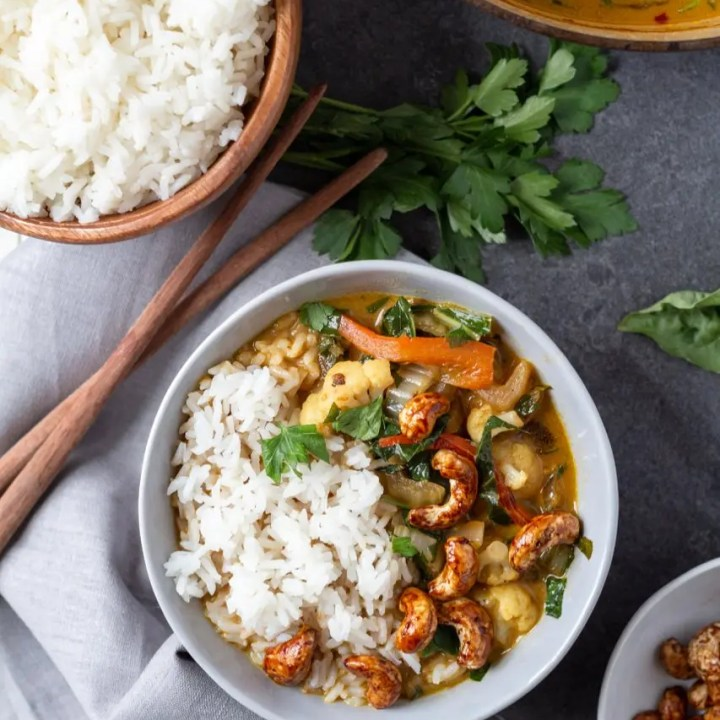 Green Coconut Veggie Curry overhead with rice bowl