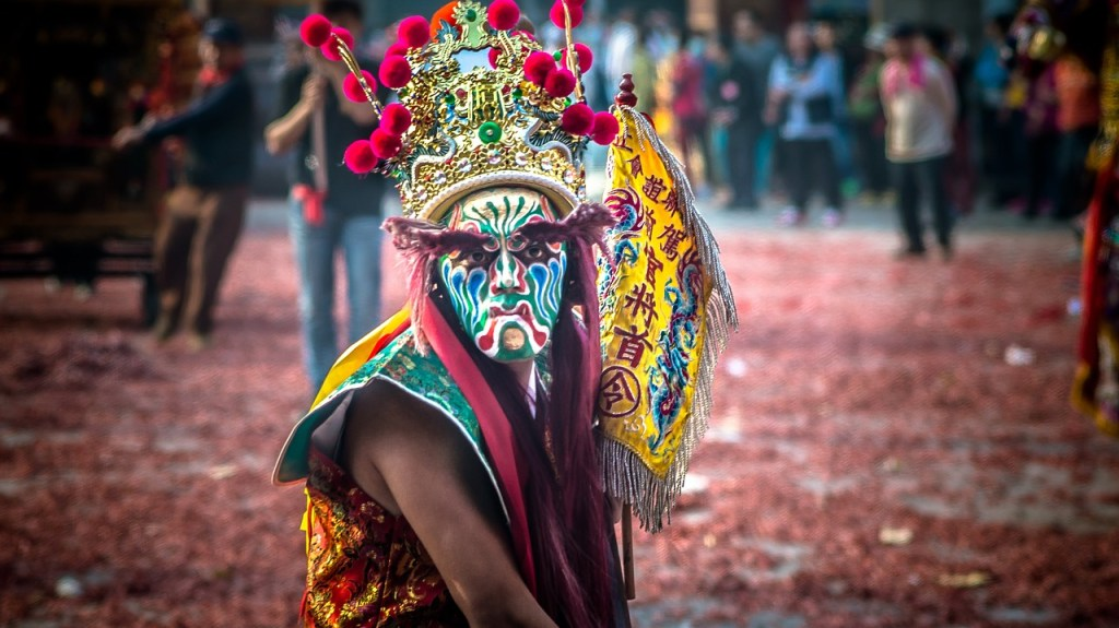 Photo: Man in costume in Taiwanese temple festival