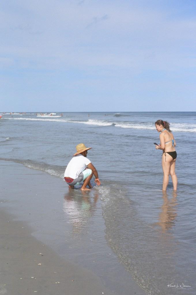 Woman Talking on Man on Avalon Beach