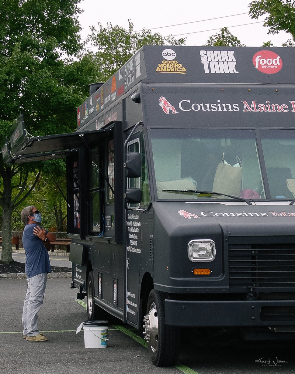 Cousins Maine Lobster food truck with customer